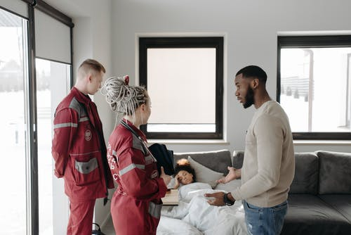 Paramedics Talking To A Man