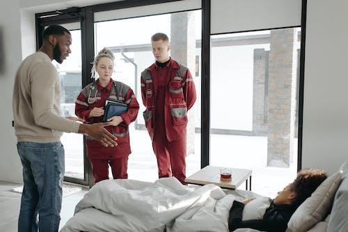 Paramedics Inside A House