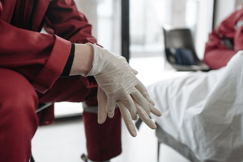Person Wearing Latex Gloves
