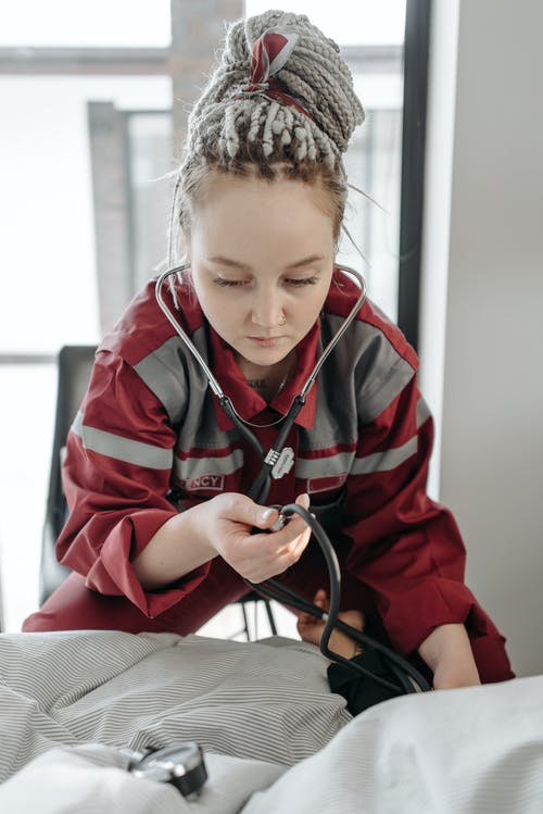 Woman Using A Stethoscope