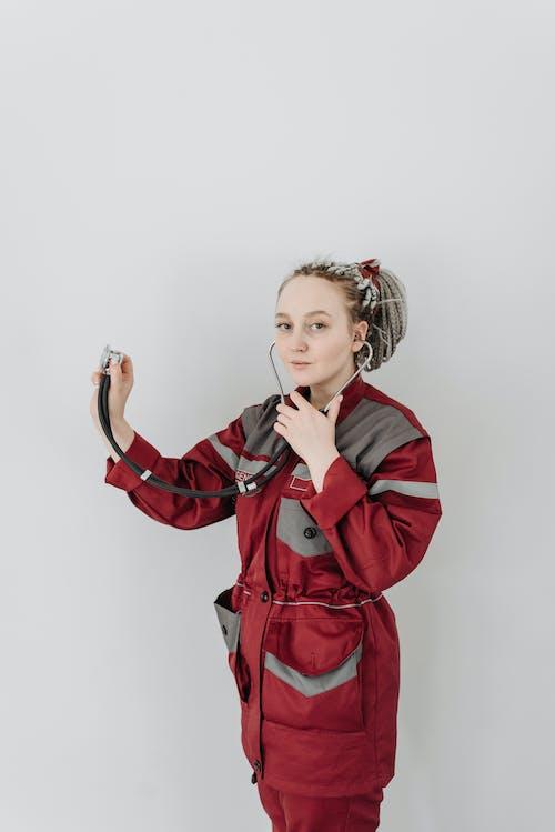 EMT In Red Uniform