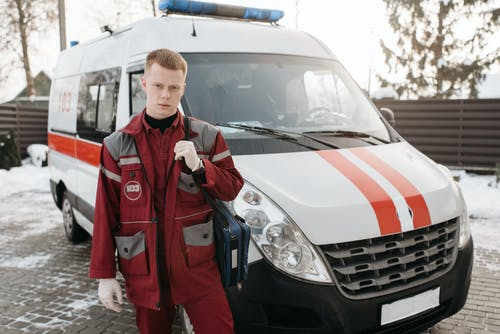 Man Standing Near An Ambulance