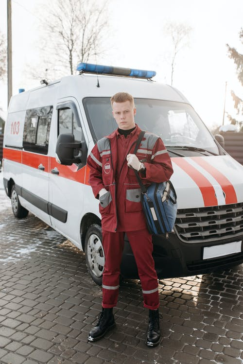 Man Standing In Front Of An Ambulance