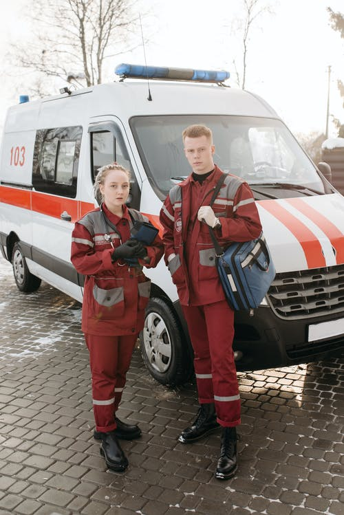 Paramedics Standing Near An Ambulance