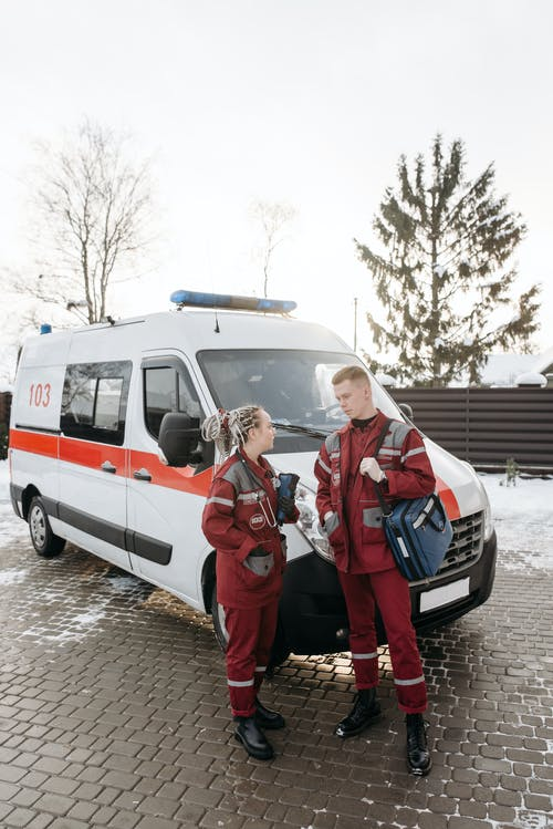 Paramedics Standing Beside An Ambulance