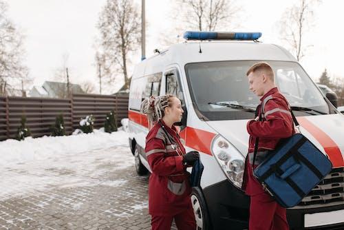 People Standing Near An Ambulance