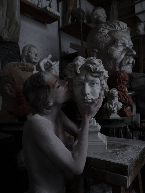 Living sculpture in workshop with bust