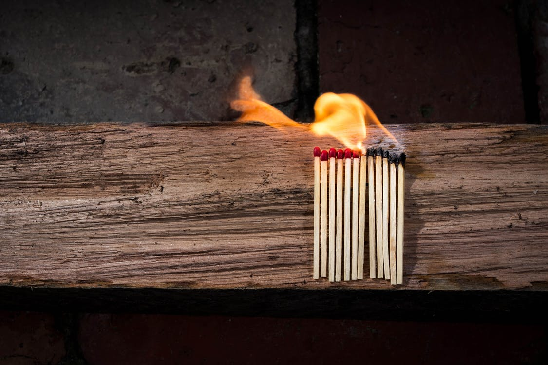 Lighted Matches on Brown Wooden Surface