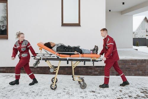 Paramedics Pushing Woman On A Stretcher