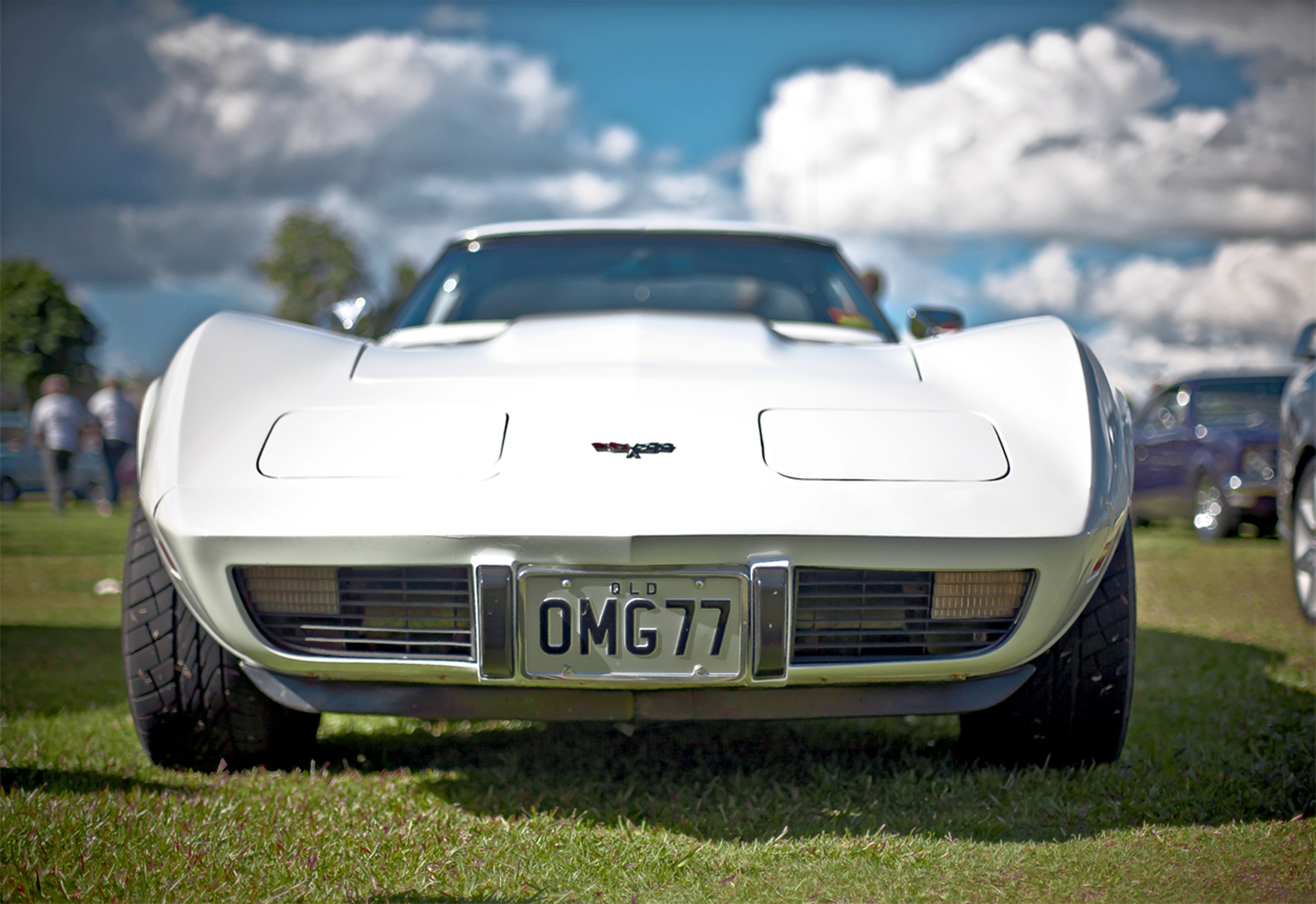 White Corvette C3 With Omg77 License Plate on Display