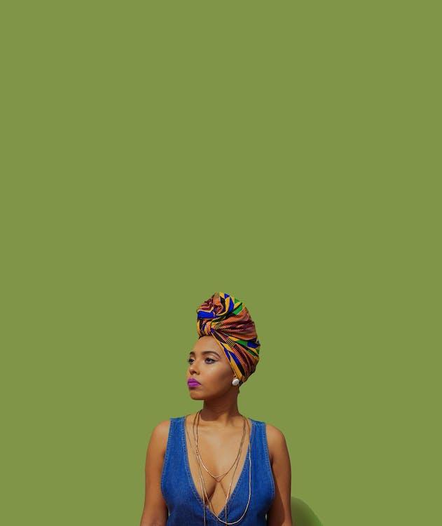 Black woman in bright headwear