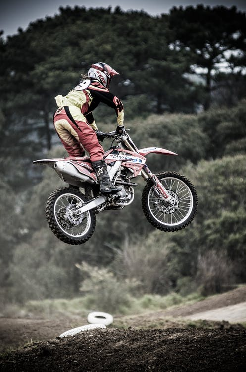 Man Performing Motocross Stunt