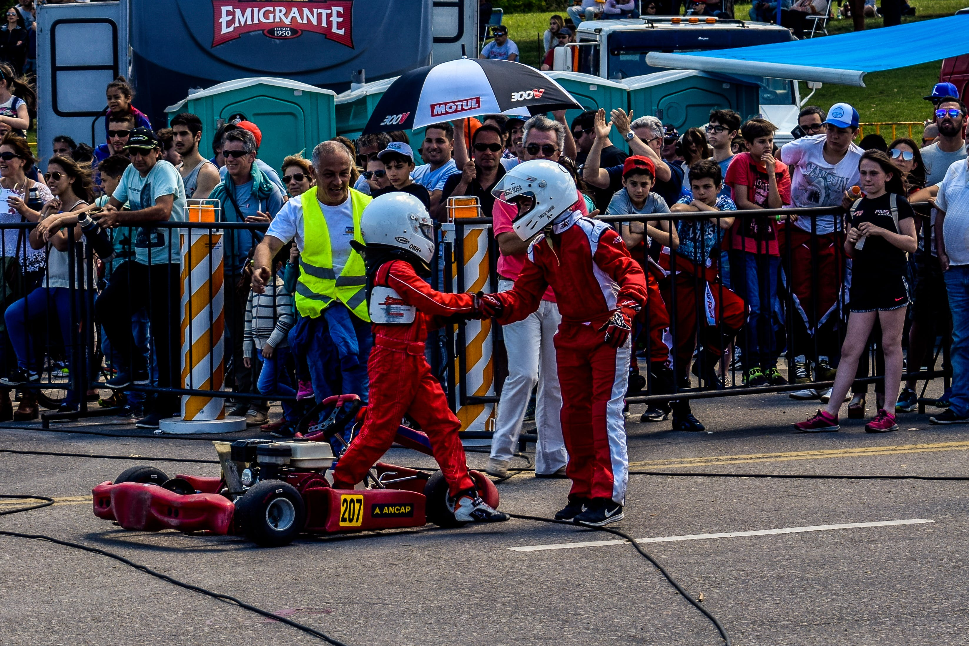 Two Boy in Red and White Racing Costume