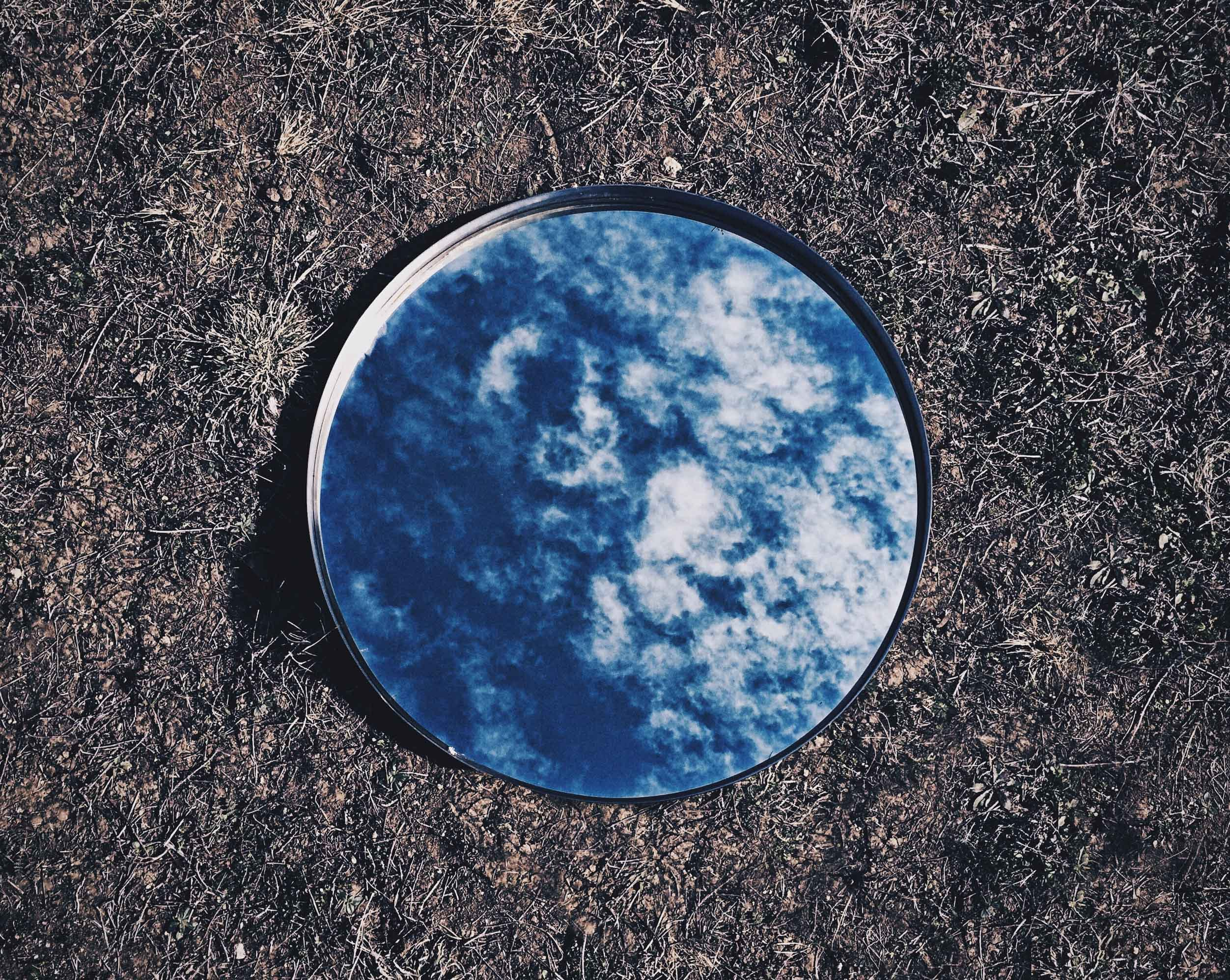 Round Mirror With Sky Reflection