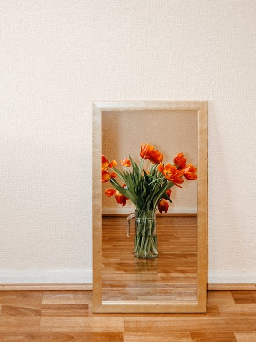 Orange Flowers in Clear Glass Vase on Brown Wooden Table