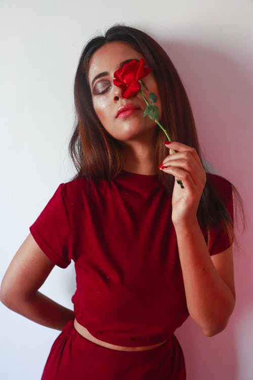 Sensual young lady with red rose