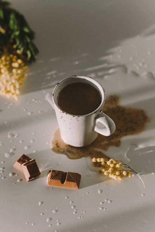 Photo Of Chocolate Bars Beside Ceramic Mug