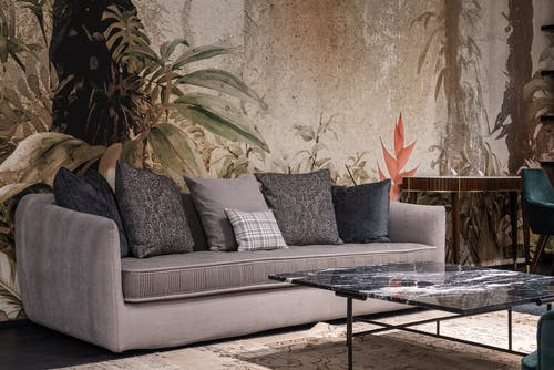 Couch with cushions in living room