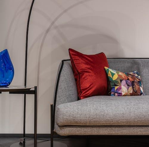 Sofa with cushions at wall
