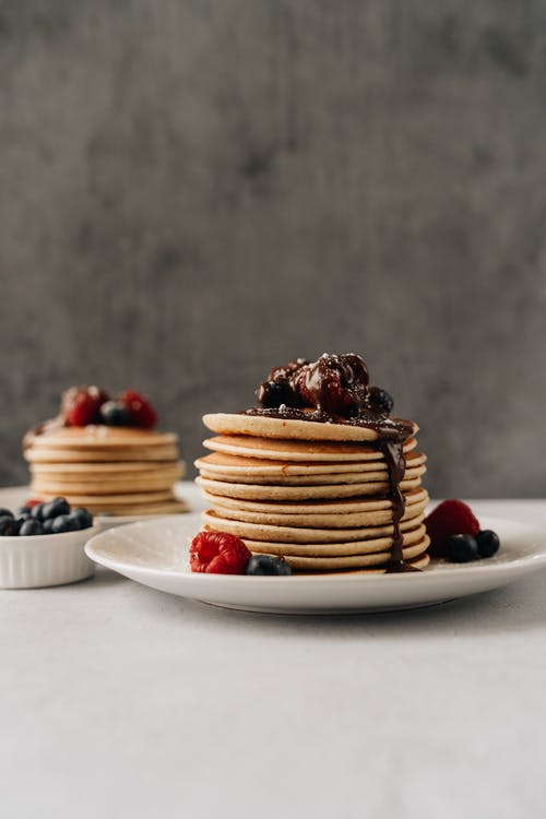 Photo Of Stacked Pancake On A Ceramic Plate