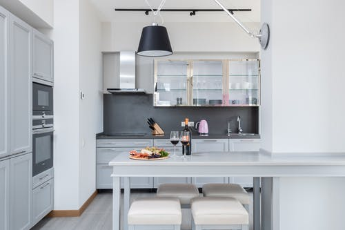 Interior of modern kitchen with wineglasses