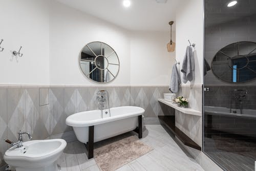 Contemporary bathroom with round shaped mirror