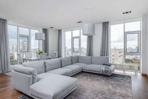Spacious living room with comfortable sofa and panoramic windows