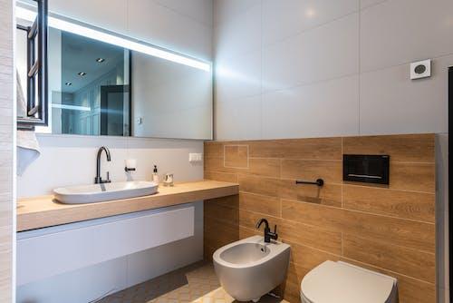Interior of stylish bathroom with toilet