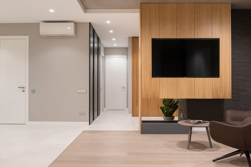 Living room with armchair and table near TV