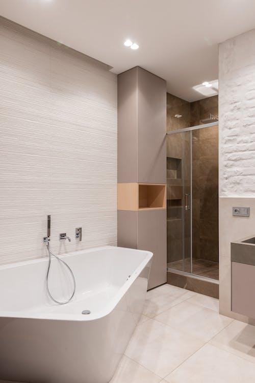 Bathroom interior with bathtub next to shower