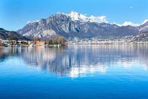 Blue Body of Water with Mountain View