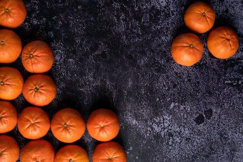 Orange Fruits on Black and Gray Surface