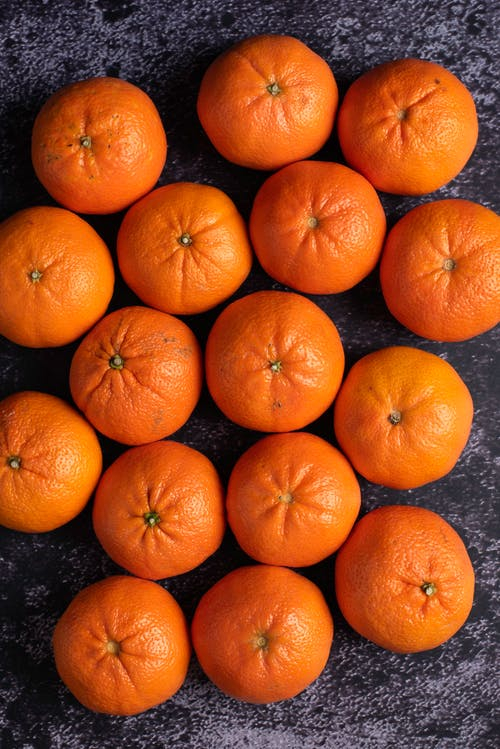 Orange Fruits on Gray Surface