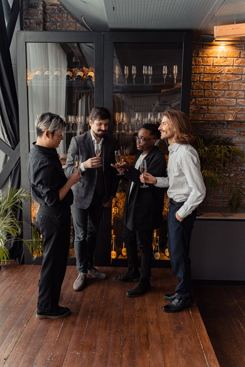 Multiracial Group of Men Holding Wine Glass
