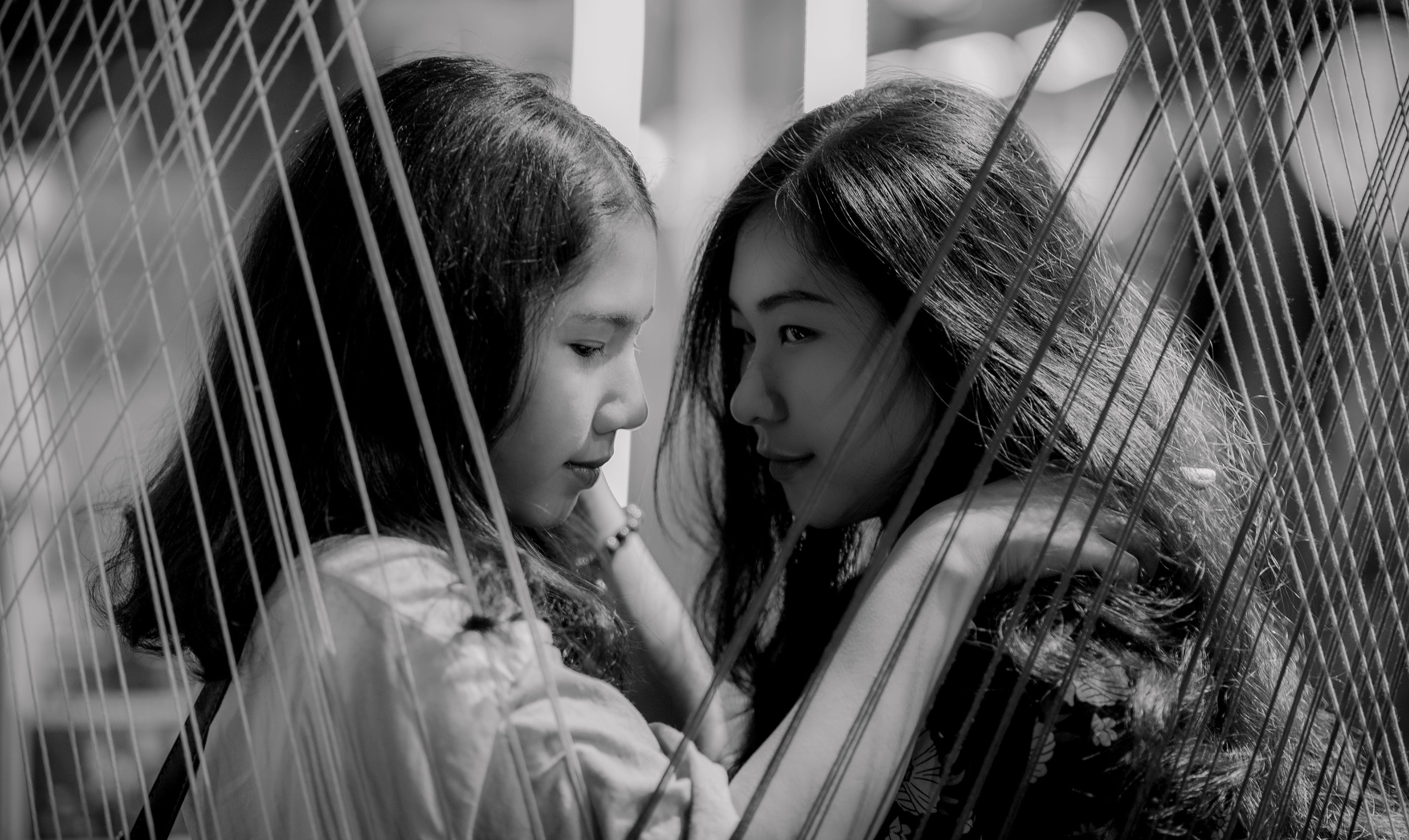 Grayscale Photography of Two Girls