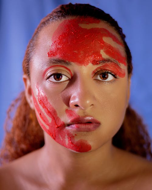 Woman With Red and White Powder on Face