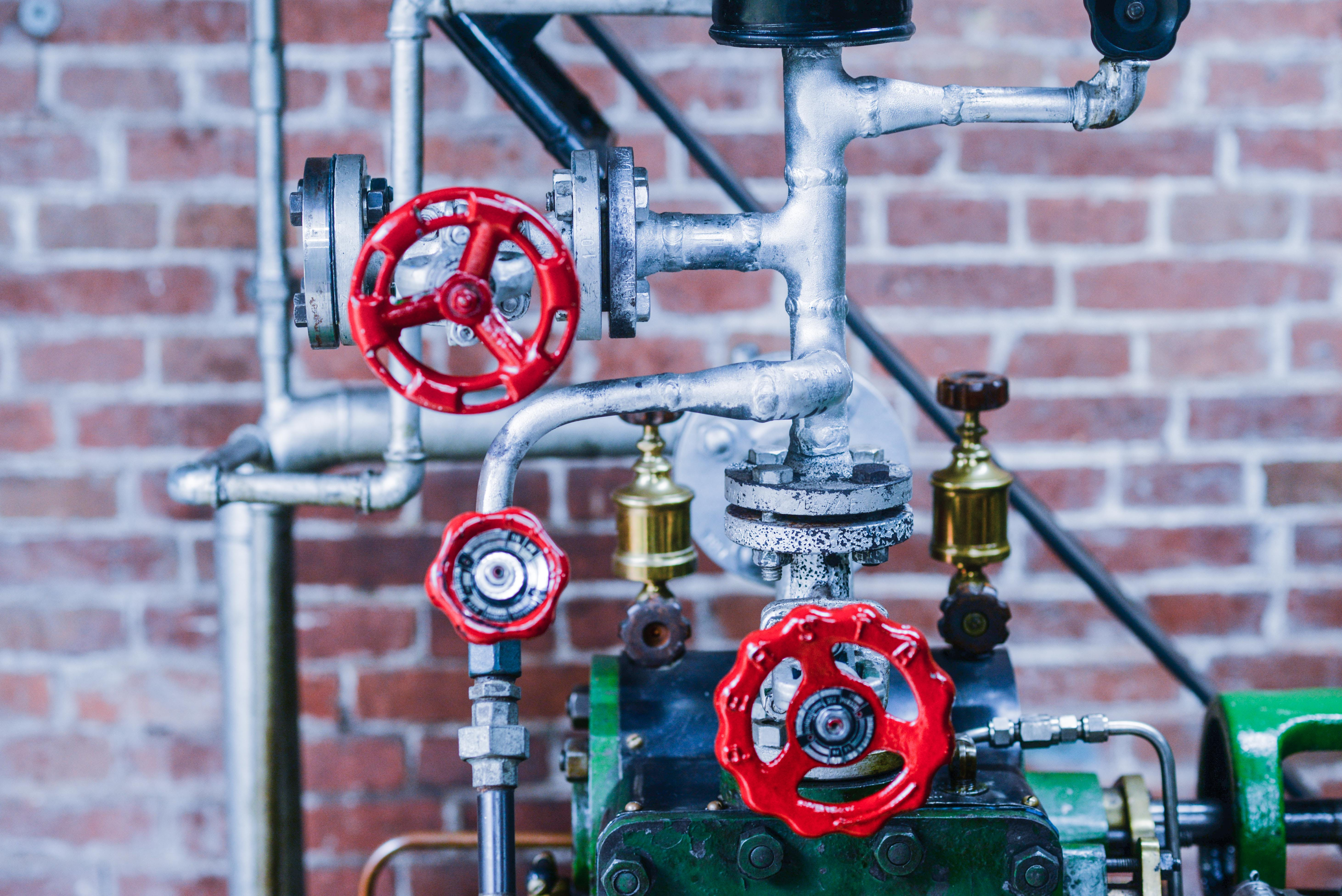 Gray Gold and Red Industrial Machine