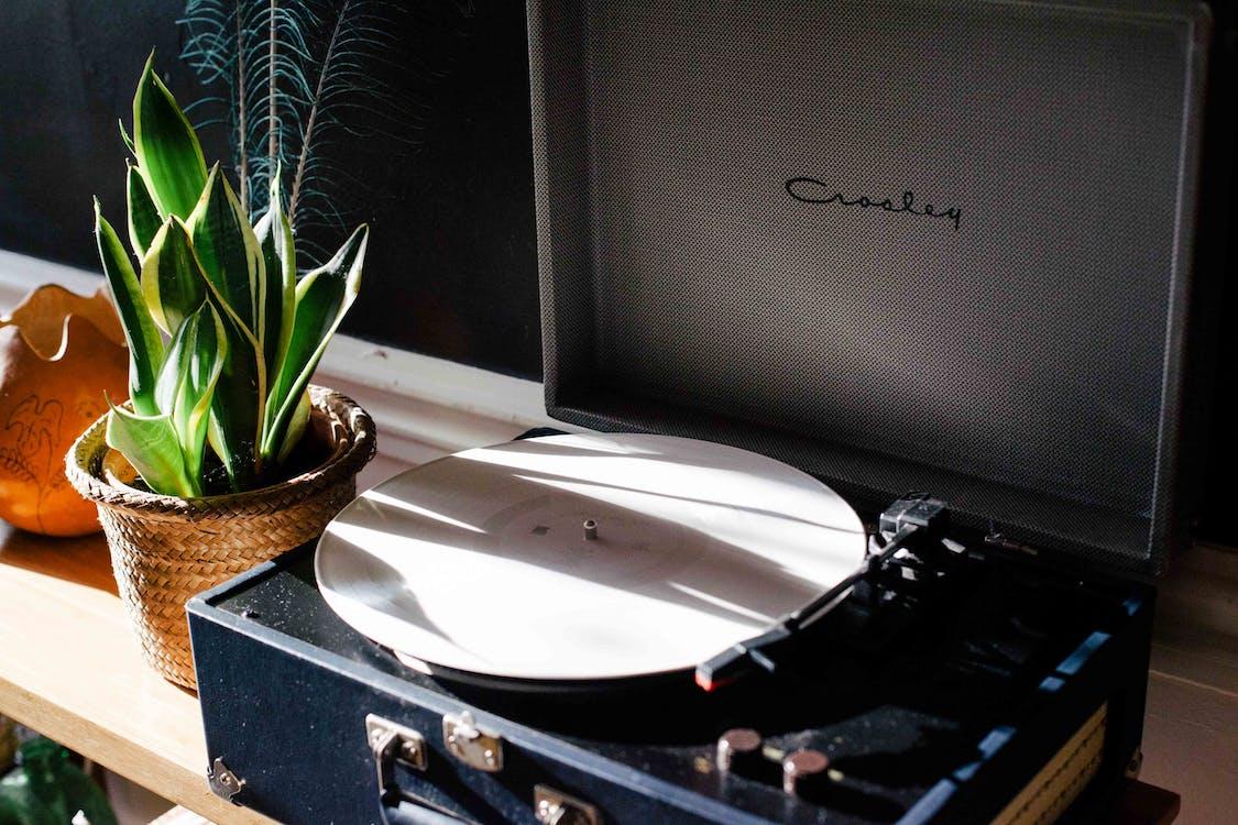 Black and White Crosley Vinyl Record Player on White Wooden Frame