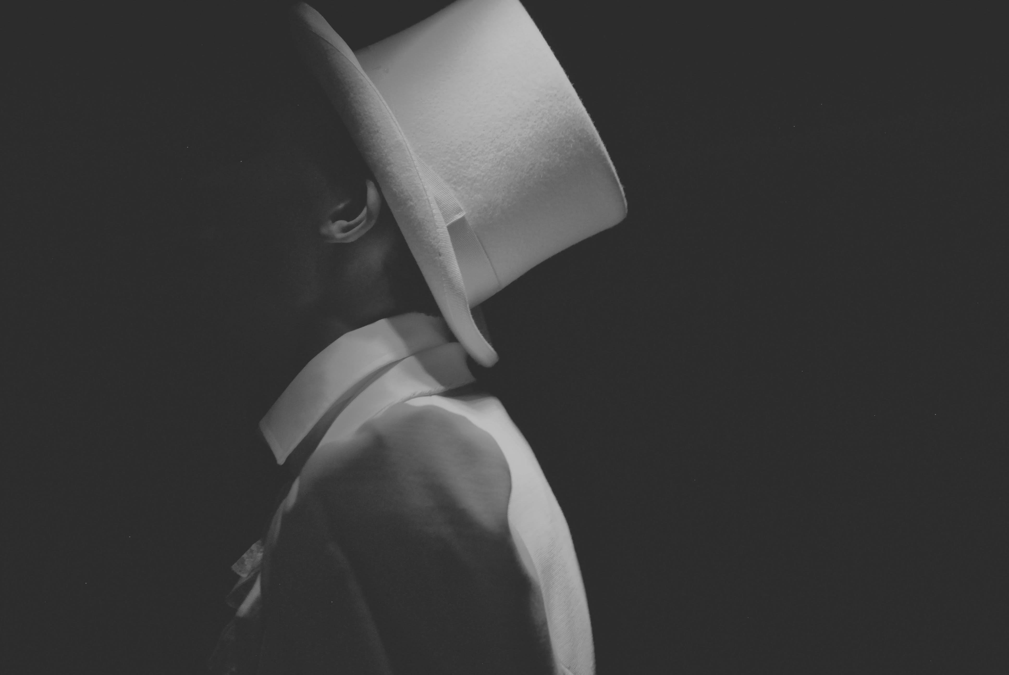 Man Wearing White Hat Greyscale Photography