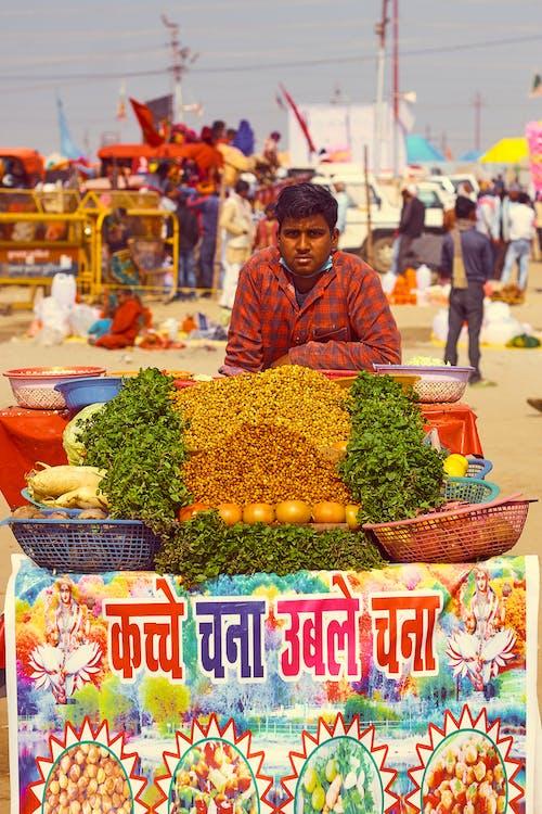Man Behind Vegetable Stand