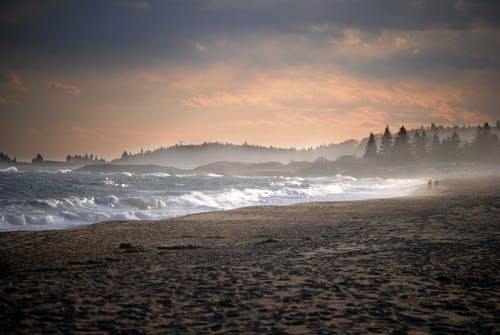 Sea waves rolling over sandy shore in scenic nature