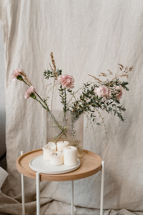 Pink Flowers on Brown Wooden Round Table