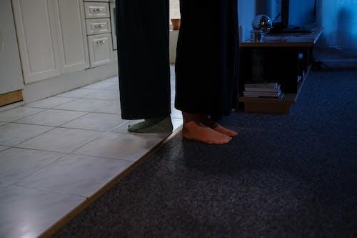 Woman in Black Skirt Standing on Gray Carpet