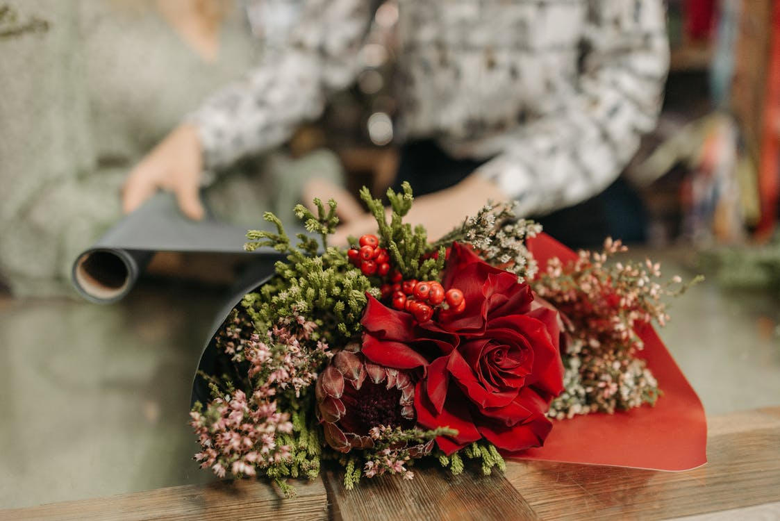 Red Rose Bouquet on Brown Wooden Table