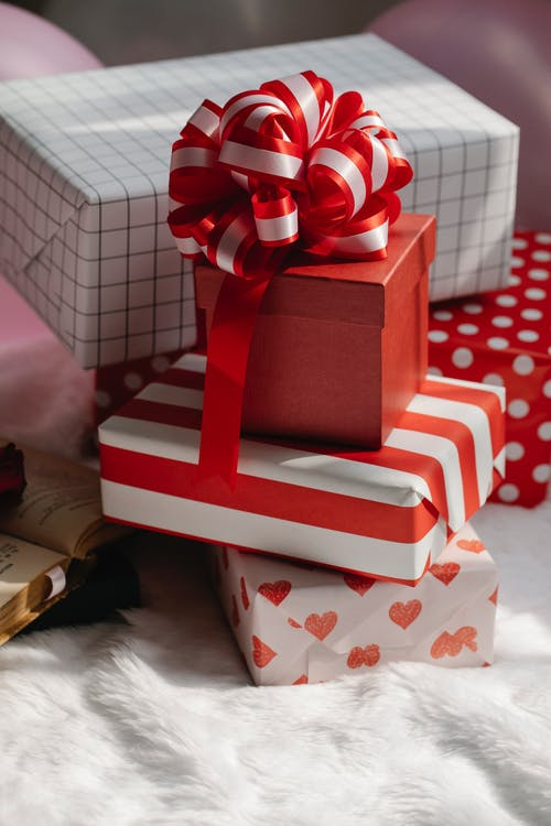 Bright red boxes of presents with ribbons