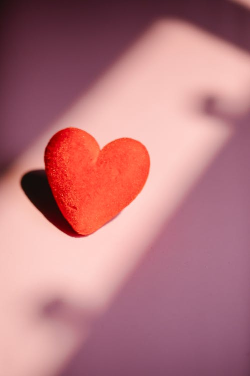 Red colored hearts on pink background