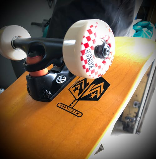 Free stock photo of close uo, orange, skateboard