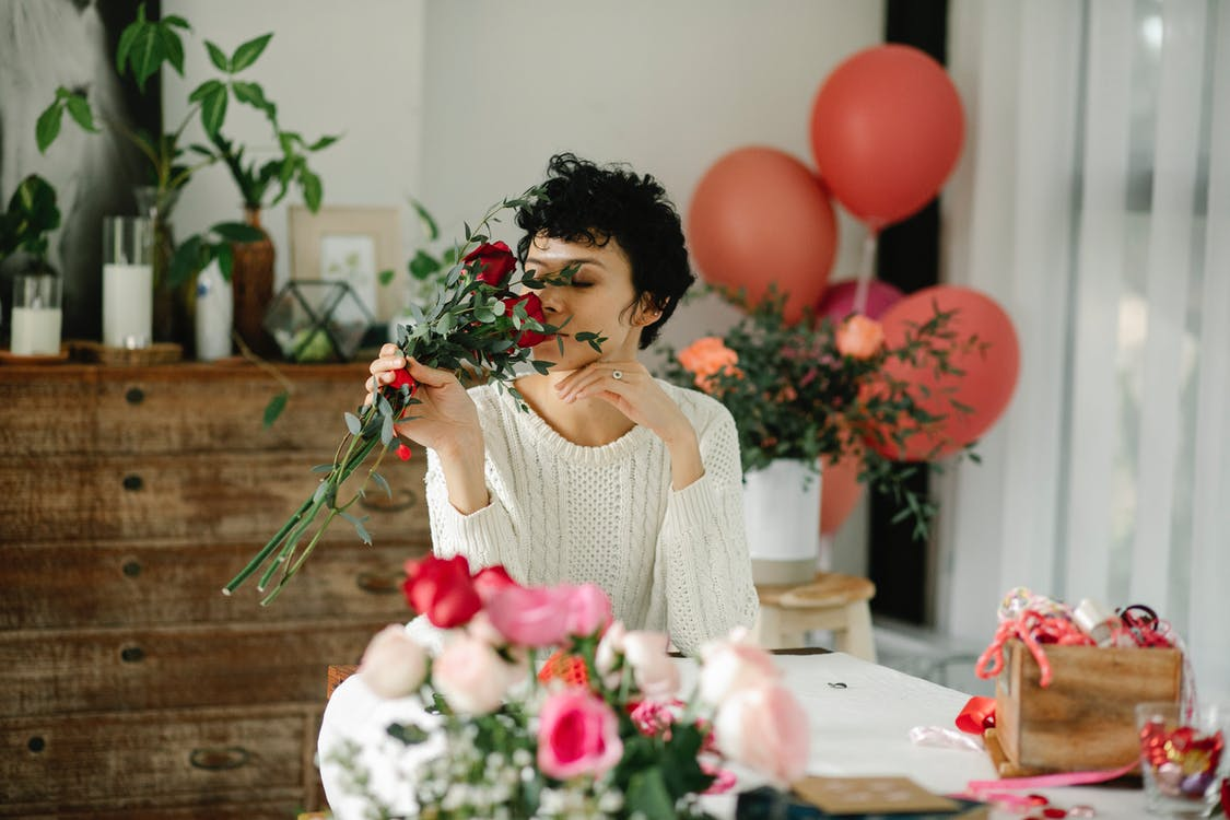 Content woman smelling bouquet of roses