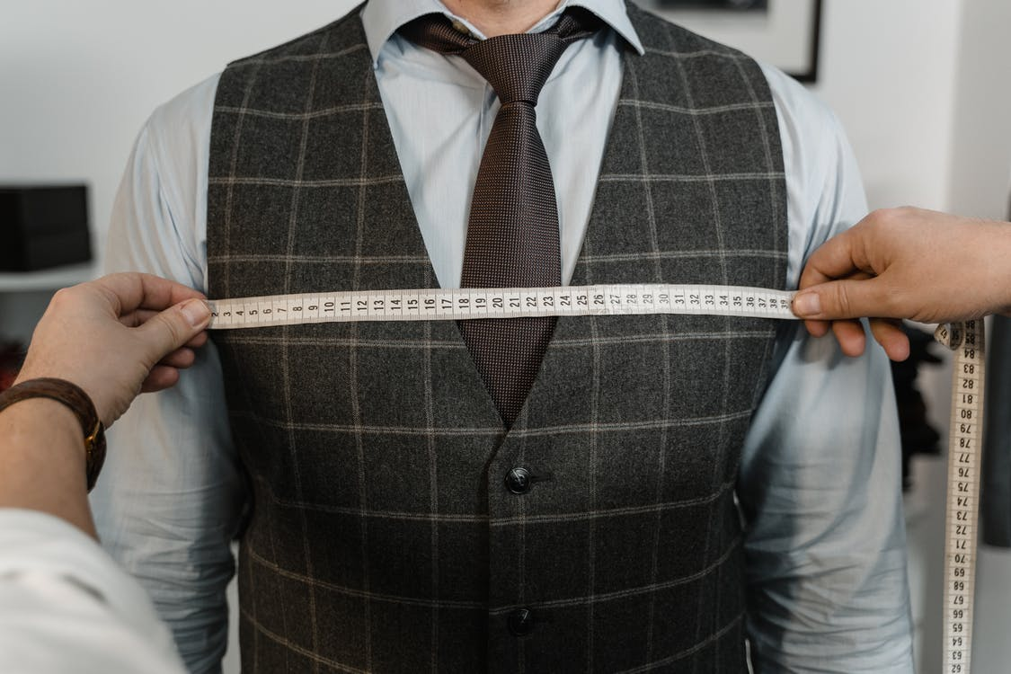 Man in Gray and White Plaid Dress Shirt With Gray Necktie