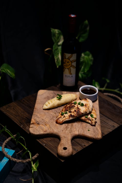 Brown Wooden Chopping Board With Bread and Coffee